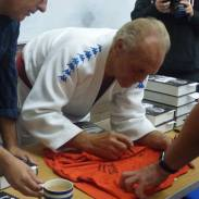 Signing Bruce's t-shirt!
