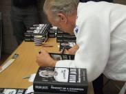 Sensei Jacks signing copies of his book