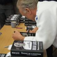 Sensei Jacks signing copies of his book